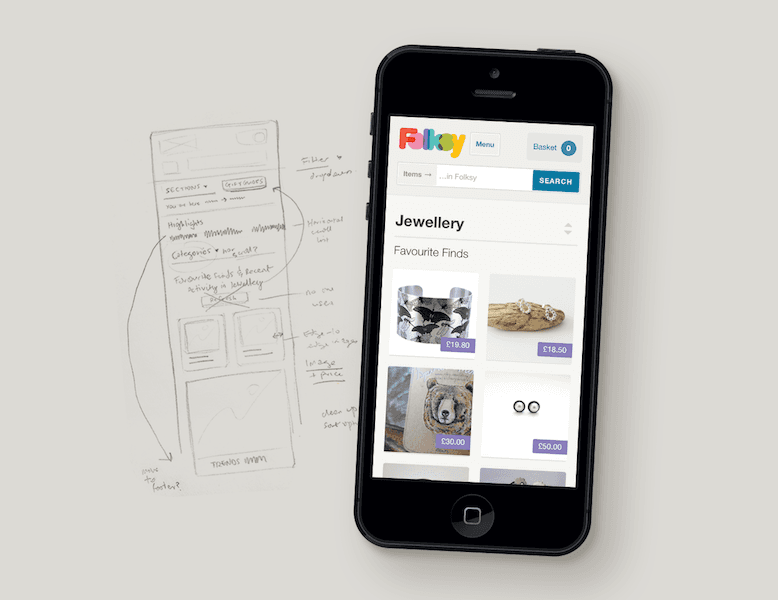 Section of a website on a smartphone alongside an interface sketch