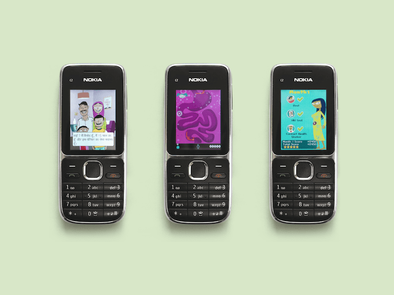 3 feature phones each displaying a different game on their screen